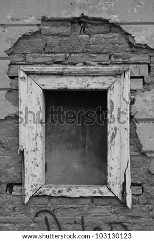 Empty window frame broken brick wall grunge background. Black and white. - stock photo