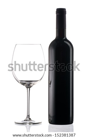 Empty wine glass and a wine bottle in white background  - stock photo