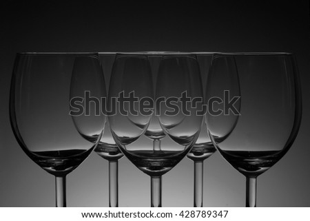Empty wine glass in brown back ground - stock photo