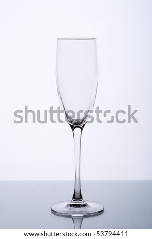 Empty wine glass on a gray background - stock photo