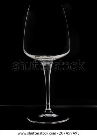 Empty wine glass on black - stock photo