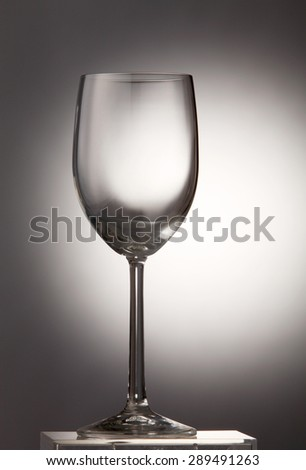 Empty wine glass on the gray background - stock photo