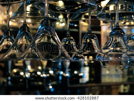 empty wine glasses, abstract art. Image is vintage effect and some noise added - stock photo