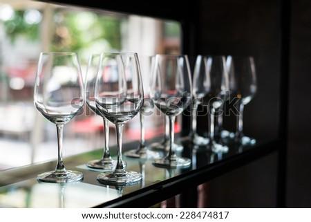 Empty wine glasses arranged in row - stock photo