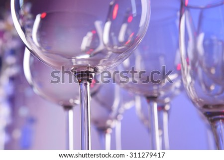 Empty wine glasses on color background - stock photo