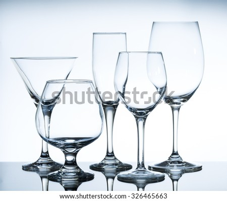 empty wine glasses on the glass table and white background - stock photo