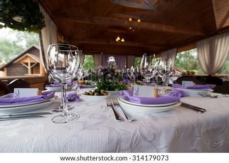 Empty wine glasses set in restaurant - stock photo
