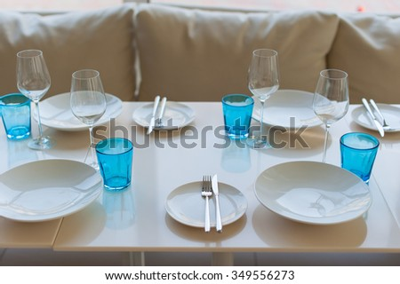 Empty wine glasses set in restaurant on a table - stock photo