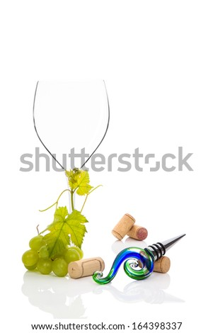Empty wineglass with green grapes isolated on white background. Luxurious wine background.  - stock photo