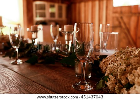 Empty wineglasses stand on the wooden table - stock photo
