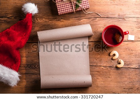 Empty wishlist for Santa Claus laid on a wooden table - stock photo