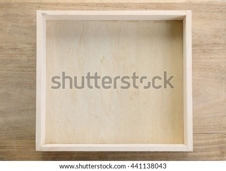 Empty wood box on wood background. - stock photo