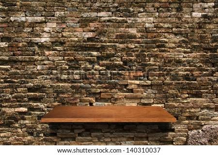Empty wood shelf on brick wall texture background, Loft style concept design - stock photo