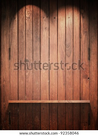 Empty Wood Shelf on wall with Top light and shadow - stock photo
