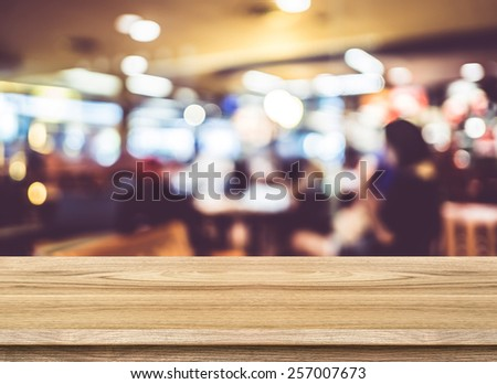 Empty wood table and blurred cafe light background. Business presentation - stock photo