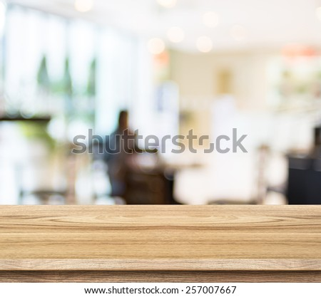 Empty wood table and blurred cafe light background. product display template.Business presentation - stock photo