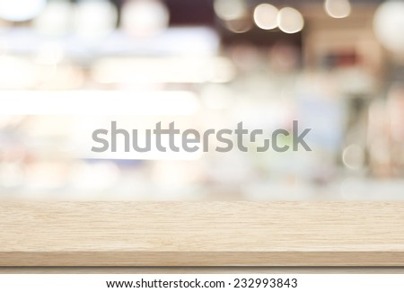 Empty wood table and blurred cafe with bokeh light background. product display template - stock photo