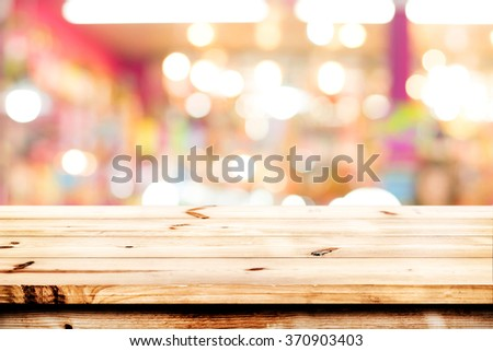 Empty wood table ready for your product display montage. Lights bokeh blurred background - stock photo