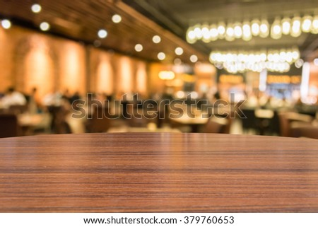 Empty wood table top on restaurant background. can montage or display your products - stock photo