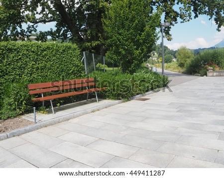 Empty wooden bench in the garden  - stock photo