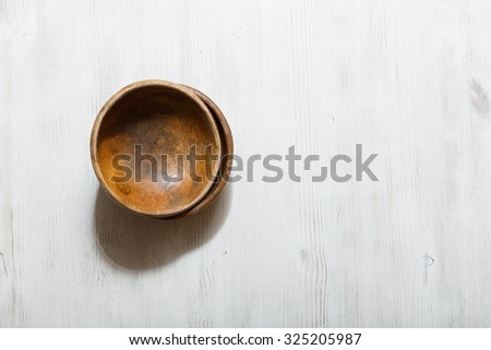 empty wooden bowls on white table - stock photo
