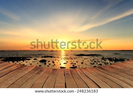 Empty wooden bridge and cloud sky background - stock photo
