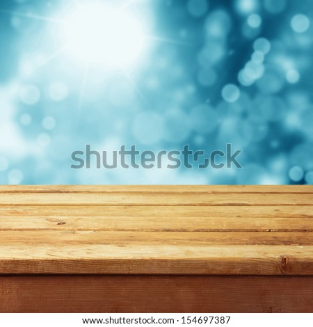 Empty wooden deck table with winter bokeh background. Ready for product display montage. Christmas background - stock photo