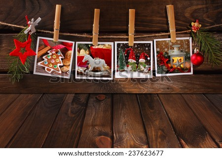 empty wooden floor and four christmas photos hanging on twine - stock photo