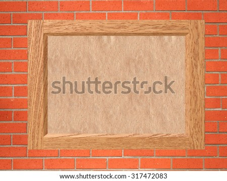 empty wooden frame with old paper on red brick wall - stock photo