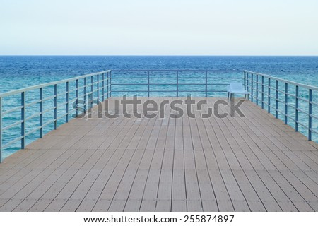 Empty Wooden Pier in the Sea. Tranquil Scene - stock photo