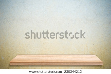 Empty wooden shelf over grunge cement wall, vintage, background, template, display - stock photo