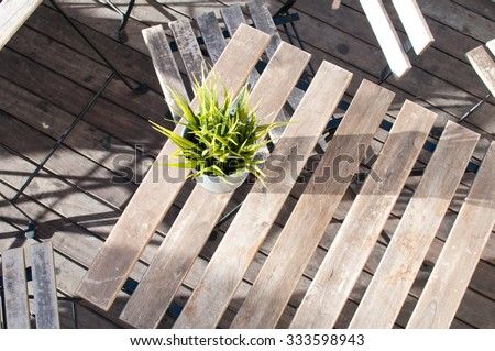 Empty wooden street cafe table - top view - stock photo