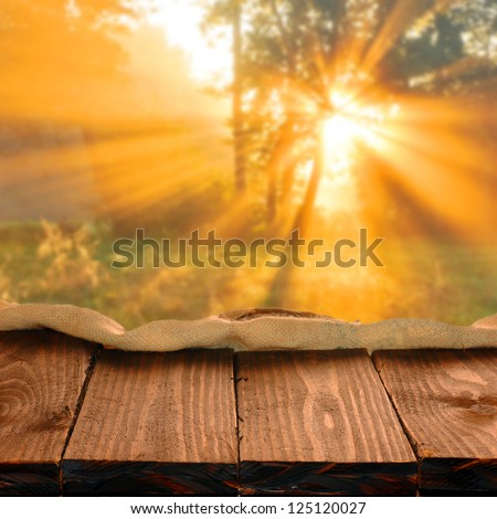 Empty wooden table for your photo montage - stock photo
