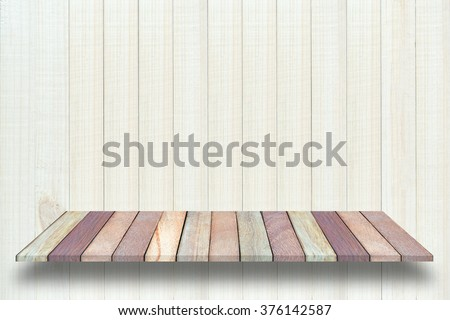 Empty  wooden table or shelf wall on wooden background, For present your products. - stock photo