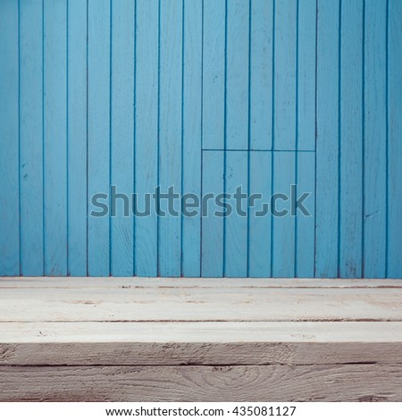Empty wooden white table over blue wooden wall - stock photo