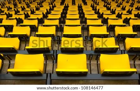empty Yellow stadium seats - stock photo