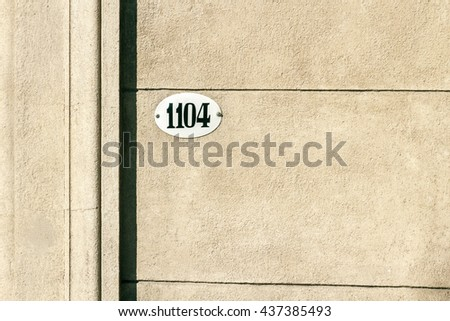 Enameled house number on facade - stock photo