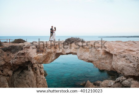 enamored young couple standing on the Bridge lovers, Cyprus - stock photo