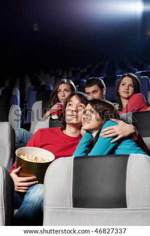 Enamoured couple at cinema in the foreground - stock photo