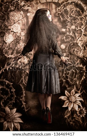 Enchanted forest girl walking through grunge illustration of painted trees and hand drawn flowers. Fairy tale concept - stock photo