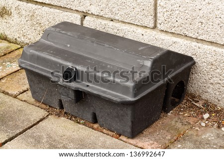 Enclosed Rat trap for laying poison to kill small mammals without the risk of harming larger animals used by pest control services - stock photo