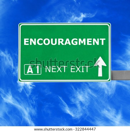 ENCOURAGMENT road sign against clear blue sky - stock photo