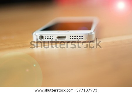 End detail of a modern smartphone with lighting effects - stock photo