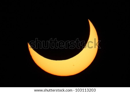 End of Annular Eclipse of May 20 2012, captured at Journal Pavilion in Albuquerque, NM - stock photo