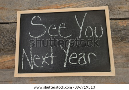 End of School Year concept written in chalk on a chalkboard on a rustic background - stock photo
