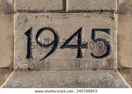 End Year of World War II Carved on a Stone - stock photo