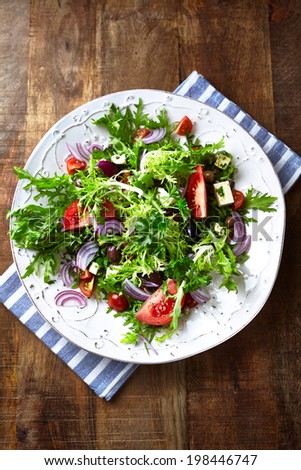 Endive Salad with Tomato, Olives and Feta - stock photo