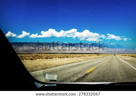 Endless roads in Arizona desert, view from inside of the car - stock photo