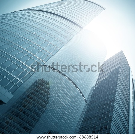 endless side of glass skyscraper in business center - stock photo