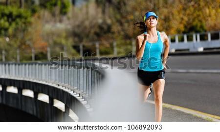 Endurance athlete training on sidewalk, running fitness marathon woman. exercise healthy lifestyle concept. - stock photo